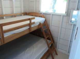 Cottage One bottom double bunk, single on top